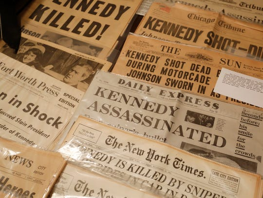 A number of newspapers from the day John F. Kennedy