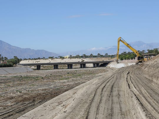 A tractor performs maintenance on an area that could be included in the CV Link bike trail in La Quinta just east of Washington St. on Tuesday, Novemeber 1, 2016.
