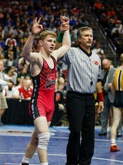 Fort Dodge's Brody Teske flashes three fingers after