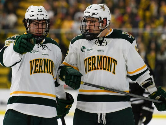 Vermont forward Alex Esposito (22) and Vermont defenseman