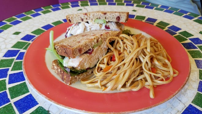The chicken salad sandwich from Orange Glory Café is simple, but memorably good (and the sesame noodle side is just one option).