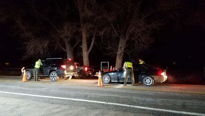Deputies from the San Juan County Sheriff's Office conduct a DWI checkpoint on County Road 6100 on New Year's Eve.