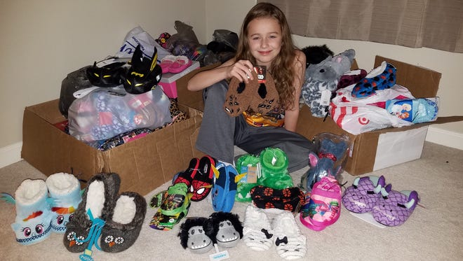 In lieu of presents, Lauralye Kennedy is collecting slippers for her upcoming 10th birthday. She plans to deliver them to young patients at the Penn State Children's Hospital in Hershey.