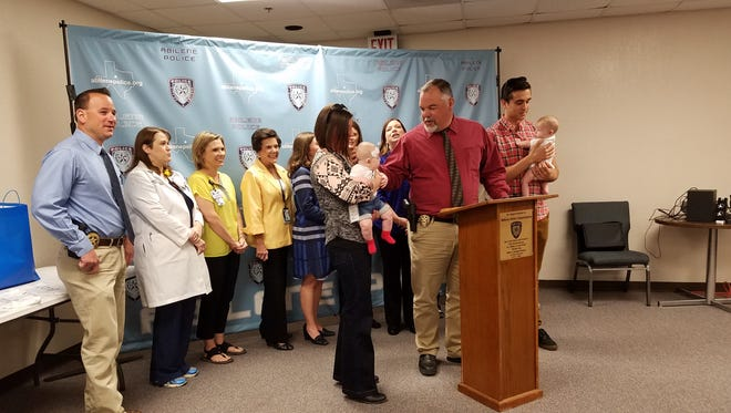 Parents, members of the The Taylor County Child Fatality Review Team and representatives of Abilene Regional Medical Center and Hendrick Medical Center gathered at the Taylor County Law Enforcement Center Monday to debut onsies designed to bring awareness to safe sleeping and Sudden Unexpected Infant Deaths.