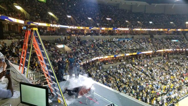 Memphis Grizzlies mascot, Grizz, chokeslams his nemesis, Natch, through a table during Game 3 of Grizzlies-Spurs