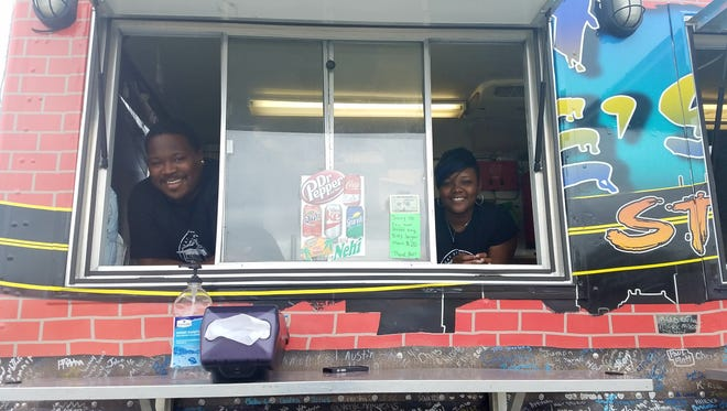 Saucy Jake's Street Food owners Jacob and Regina Richmond at their food truck on 587 Vann Drive in Jackson.