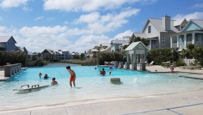 Families enjoy one of Cinnamon Shore's pools on a spring day. Developers are planning major expansions for the area expected to total $1.3 billion.