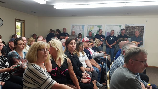 Residents crowd into the Ira Township meeting room for a special board meeting on Monday, May 22, 2017.