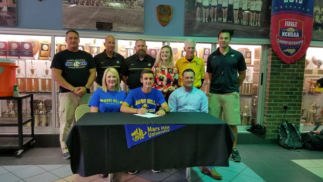 Murphy's Ethan Murray has signed to run college track for Mars Hill.