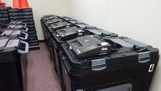 Several of the new election tabulators are lined up in the city clerk's office of Port Huron's Municipal Office Center.