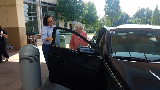 Rider Grace Heaberg and volunteer MyRide driver Wendy Perdue getting ready to take off in Jackson, Tenn.
