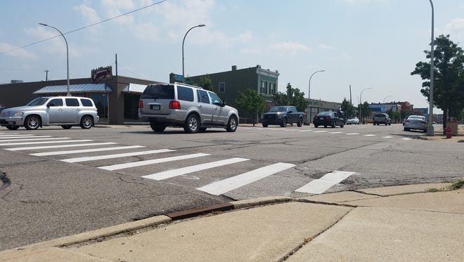 Cars pass through the intersection of Beers Street and Huron Avenue just north of downtown Port Huron on Monday, Aug. 21, 2017. The corner was one of three areas where the city planned to test effectiveness in calming traffic with new crosswalk signs.