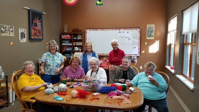Woodlands Senior Park residents and Christ Child members working on upcoming craft sale items. Pictured are, seated from left: Betty Pinske, Mary Ann Laimers, Marion McEssey, Mary Ann Pfister, and Diana Klement; standing from left: Marilyn Ryan, Donna Gagne and Lori LaPoint.