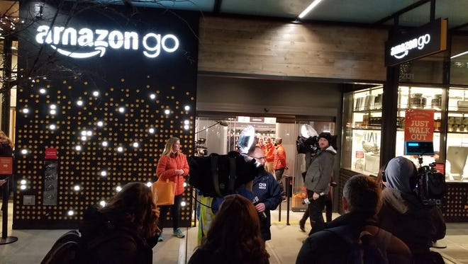 Crowds outside the Amazon Go checkout-free convenience store in Seattle on Monday, Jan. 22, 2018 as it opened to the public.