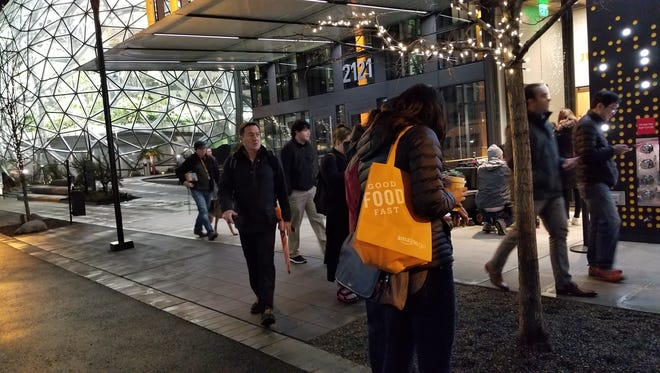 Shoppers outside Amazon's Amazon Go checkout-free convenience store, which opened to the public on Monday, Jan. 22, 2018.