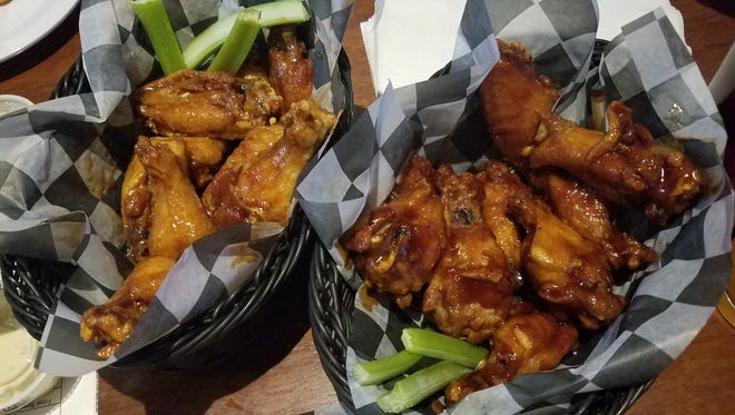 Maple BBQ, left, and Thai BBQ chicken wings at McGillicuddy's Five Corners in Essex Junction, Monday, Jan. 29, 2018.