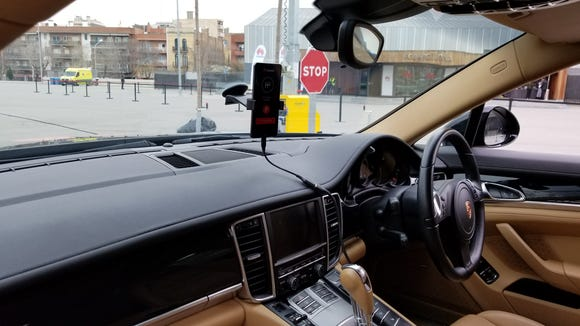 There is no driver except a smartphone in this Porsche