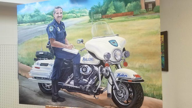 A painting of officer Rodney Holder by Abilene artist Kina Tiemann. Holder died in a motorcycle accident April 29, 2010, after serving in the Abilene Police Department for almost three decades.