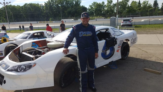 Johnny Sauter poses next to his short track late model prior to competing June 21 at Wisconsin International Raceway in Kaukauna.
