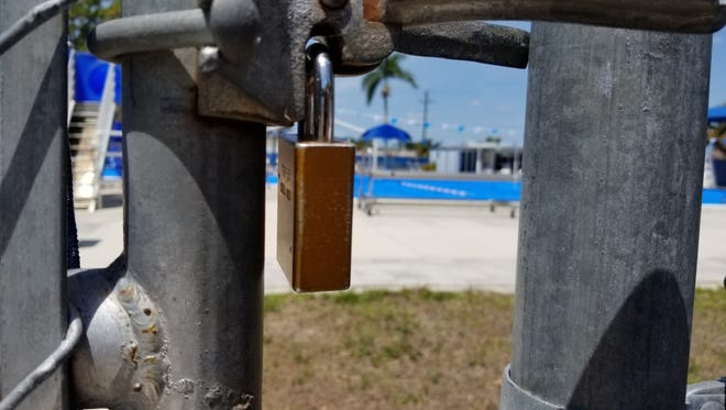 The locks stayed on at the North Fort Myers Community Pool through the spring. A new pool will be built, expected to reopen early in 2019.