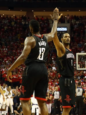 Houston Rockets guard James Harden and forward Trevor Ariza high-five during the fourth quarter of Game 5.