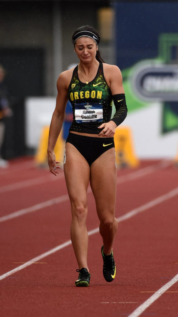 Jun 9, 2016; Eugene, OR, USA; Hannah Cunliffe of Oreogn reacts after failing to finish a women's 100m semifinal during the 2016 NCAA Track and Field championships at Hayward Field. Mandatory Credit: Kirby Lee-USA TODAY Sports