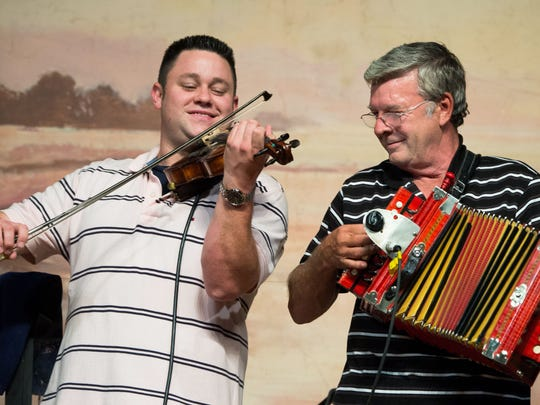 Johnny Sonnier, right, places with fiddler Jason Bergeron during a 2014 show at the Liberty Theater in Eunice.