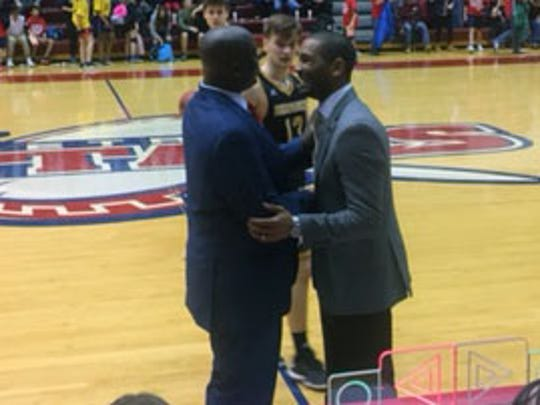 Detroit Mercy coach Bacari Alexander, left, and Milwaukee coach LaVall Jordan, both former assistants at Michigan, shake hands after UDM's 73-69 overtime loss Friday at Calihan Hall.