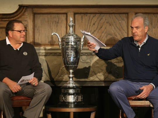 PGA of America President Paul Levy (L) with Tim Thaney, president of Oak Hill Country Club announce that the PGA Senior Championship will be held at the Pittsford golf course in 2019.