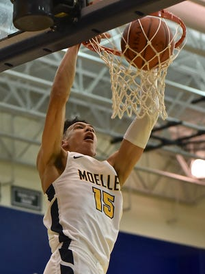 Moeller's Jaxson Hayes with a first half slam dunk against Elder Friday, January 26th at Moeller High School