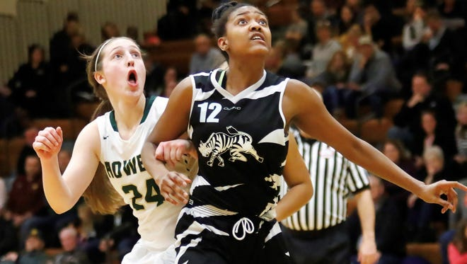 Wayne's Jayah Hicks (12) and Howell's Leah Weslock (24) battle for position in Wayne's 50-46 victory over Howell Thursday February 22, 2018 in Howell.