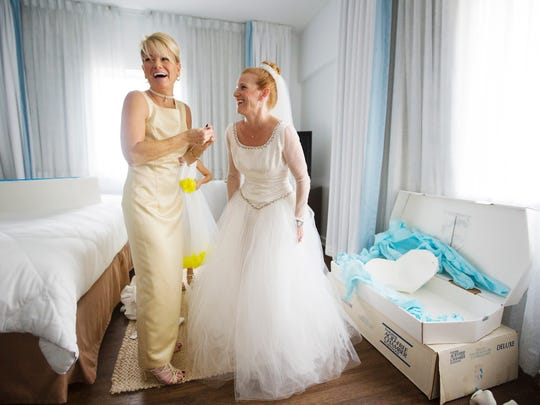 Kerry Sweezey, left, with her sister Charlene Couillard moments before Couillard renewed her wedding vows on Saturday at the Hotel Indigo in downtown Fort Myers. Couillard was celebrating 20 years of marriage to Craig Couillard.