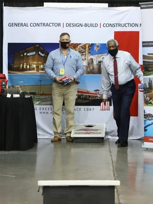 Adam Shelton with Hydco General Contractors and Construction Management, left, throws a game of cornhole with Fort Smith Mayor George McGill, Thursday, September 3, during the Arkansas Recreation & Parks Association Conference and Trade Show at the Fort Smith Convention Center. Scheduled through September 4, the event features Chris Nunes, CPRE, Director of Parks and Recreation for The Woodlands Township, in The Woodlands, Texas and is the first vendor booth conference since March 15, 2020, due to the COVID-19 pandemic.