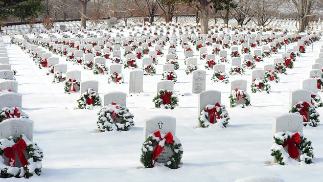 Snow blankets the U.S. National Cemetery in Fort Smith during a past Christmas Honors program. The annual event is being moved to Chaffee Crossing this year as a drive-thru event. The public can start enjoying the Christmas Honors Tribute at the Chaffee Crossing exhibit, 7300 Buckhorn St., on Saturday, Dec. 5, beginning at 10 a.m. The last day the tribute will be open is scheduled for Monday, Dec. 28.