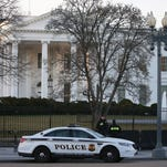 Members of the Secret Service guard the White House on March 12.