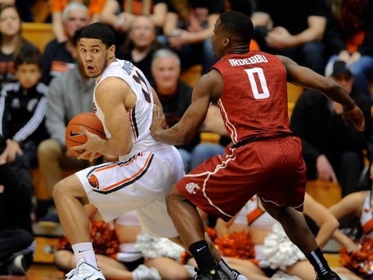 Washington State's Ike Iroegbu (0) defends against Oregon State's Malcolm Duvivier (11) during the first half in Corvallis.