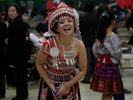 Michelle Lor of Wausau laughs as she plays the traditional ball-tossing game with a male partner at the Hmong New Year celebration at Greenheck Field House in Weston in 2013.