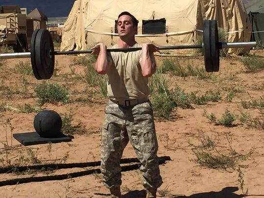 A soldier works out at a mobile gym that is designed