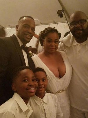 Jill Scott poses for a photo with her husband Mike Dobson, his friend DJ Mars and Dobson's sons.