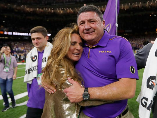 LSU head coach Ed Orgeron hugs his wife Kelly after winning the national title.
