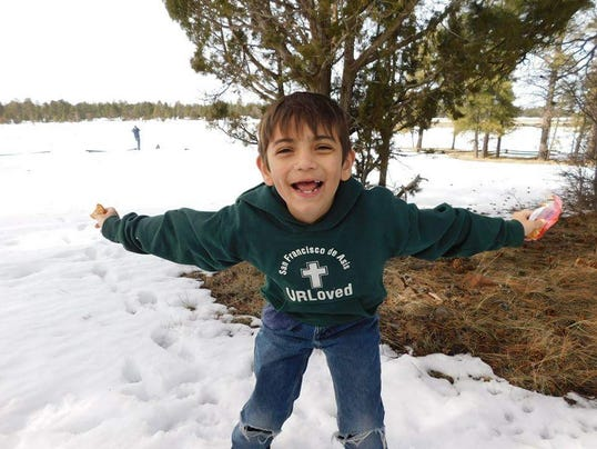 Eight-year-old Acis Raiden Garcia is looking for the Good Samaritan he said saved his life when he was swept away in the flash-flood in Payson.