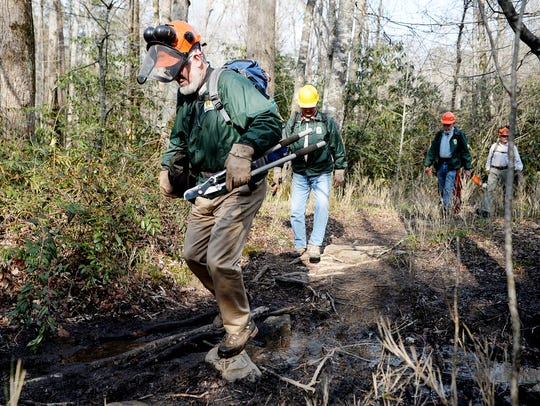 Don Herman walks along the Davidson River Trail April