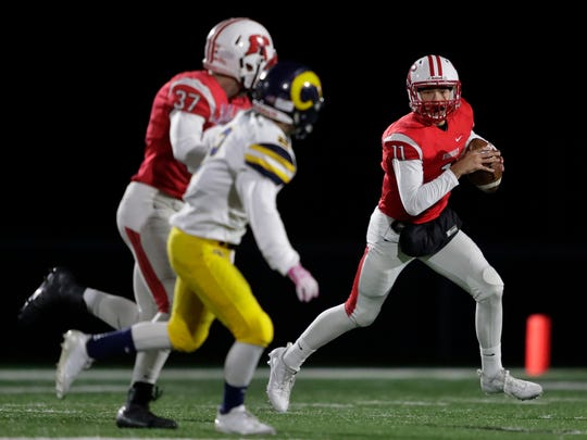 Kimberly High School's Alec Rosner (11) looks to pass against Marquette University High School during their WIAA Division 1 football second round playoff game Friday, October 27, 2017, at Papermaker Stadium in Kimberly, Wis. Dan Powers/USA TODAY NETWORK-Wisconsin