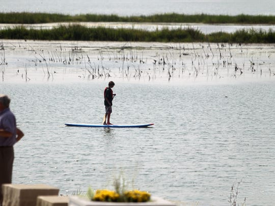 A paddleboarder enjoys the lake Saturday at the Terry