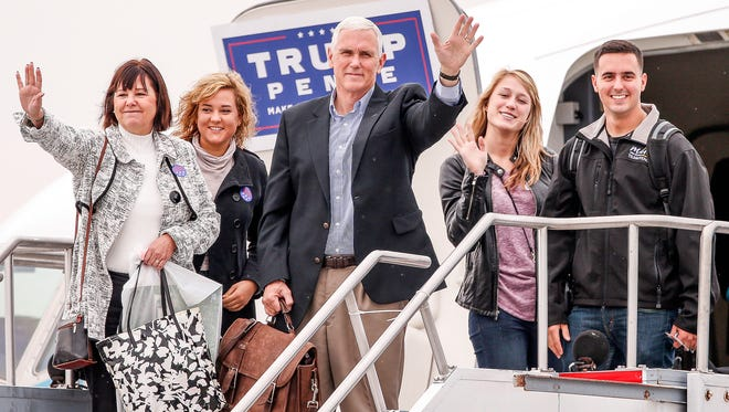 Indiana Gov. Mike Pence, the Republican vice-presidential nominee, along with wife Karen, daughter Charlotte and son Michael, with fiancé Sarah Whiteside, prepare to depart out of Million Air Indianapolis to fly to New York on Tuesday, Nov. 8, 2016.