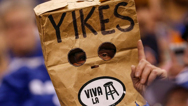 An Indianapolis Colts fan puts a bag on his head after a Denver Broncos touchdown at Lucas Oil Stadium in Indianapolis on Thursday, Dec. 14, 2017.
