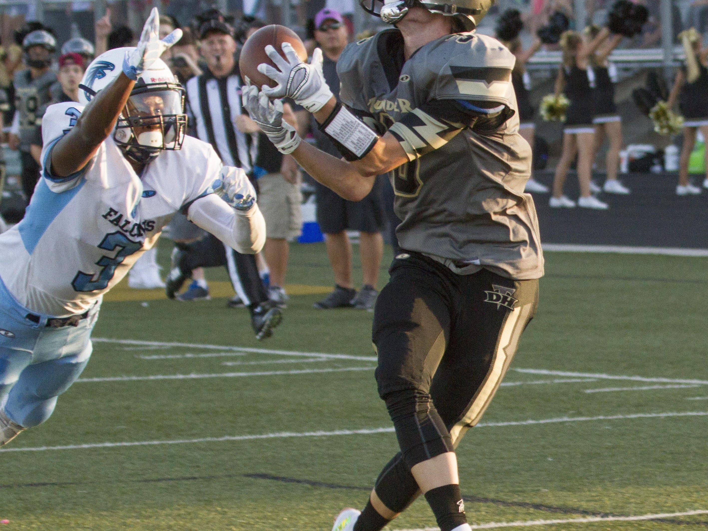 Desert Hills wide receiver Garrick Sharp catches a pass for a touchdown against Foothill High Friday, Aug. 28, 2015.