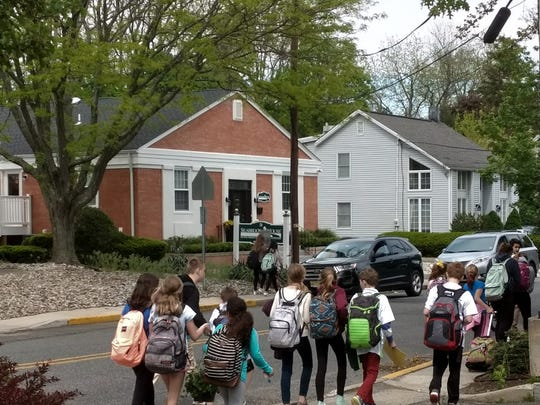 Students walk home from school past new treatment center
