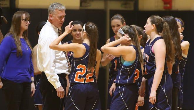 Briarcliff girls basketball head coach Don Hamlin talks to his team during a game.