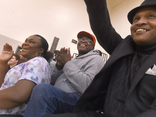 """Marcia, left, and Horace Walker, center, cheer for their son, Jarace,14, during a recent game at Susquehannock High School. """"Jarace would rather give those kids a layup than him having a layup,"""" said Horace of his son.  """"When he does that it elevates them and gives them confidence."""""""